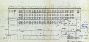 Tegning, snitt, av det nå nedlagte hovedpostkontoret, nå kjøpesenteret Exhibition, sett fra Rådhusgaten-Småstrandgaten. Arkivet etter Bygningssjefen, Bergen Byarkiv.