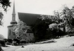Storetveit kirke fra 1930. Tegnet av arkitekt Ole Landmark. Fotograf: Øyvind H. Berger. Fotoregistrering av Bergen, Bergen Byarkiv.
